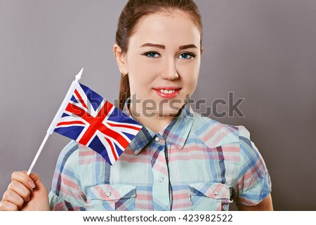 Cheerful woman with british flag