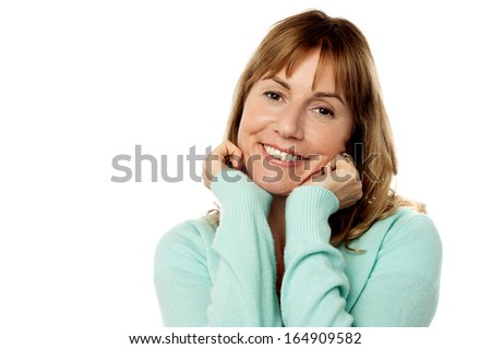 Cheerful woman with hands on her cheeks - stock photo