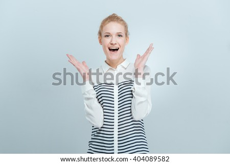 Cheerful woman with mouth open looking at camera isolated on a white background - stock photo