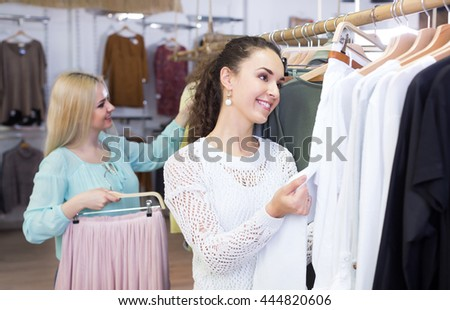 Cheerful women shopping skirt and trousers at the store