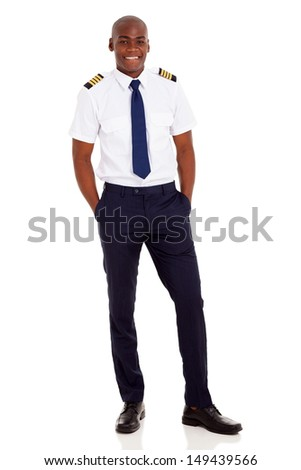 cheerful young african airline pilot standing over white background - stock photo