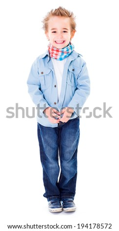 Cheerful young boy smiling on white background - stock photo