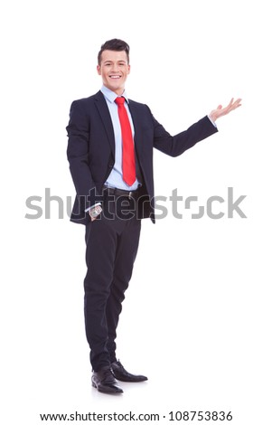 cheerful young business man greets you an white background - stock photo