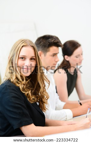 cheerful young business woman with partners in  meeting room