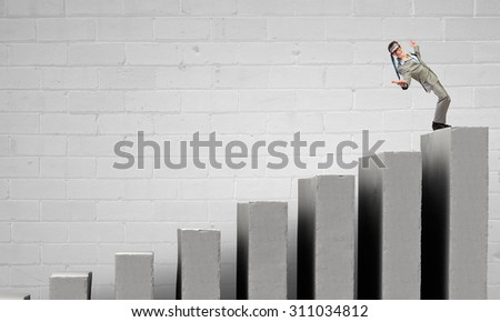 Cheerful young businessman with tie around head - stock photo