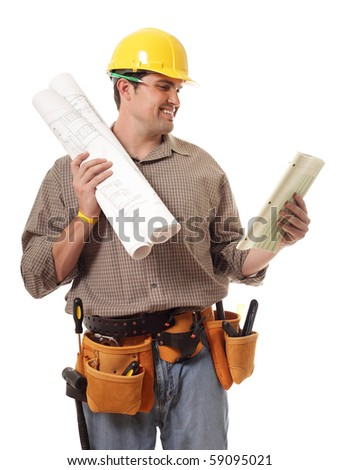 Cheerful young construction worker reviewing paperwork - stock photo