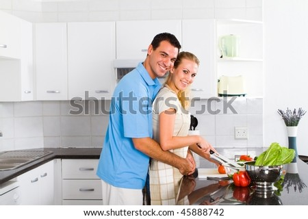 cheerful young couple in home kitchen