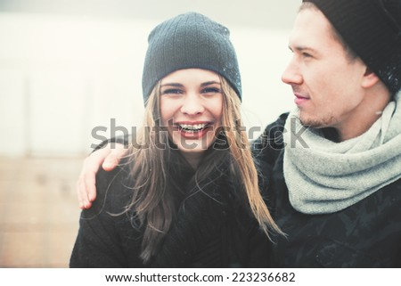 cheerful young couple in love on a sunny day - stock photo