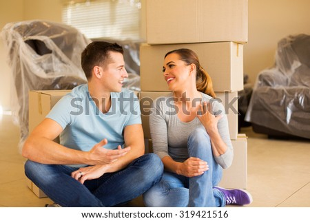 cheerful young couple relaxing in new house - stock photo