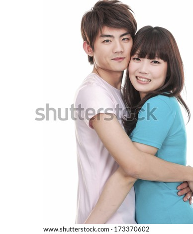 Cheerful young couple standing - stock photo