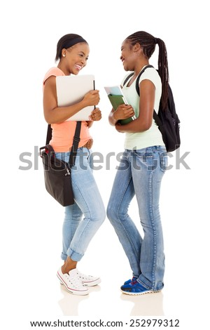 cheerful young female african college students having conversation on white background - stock photo