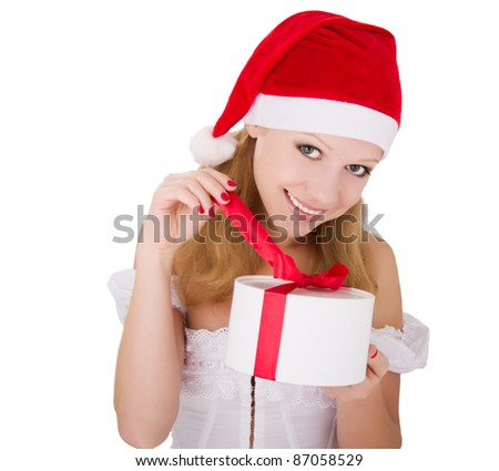 cheerful young girl with Christmas present