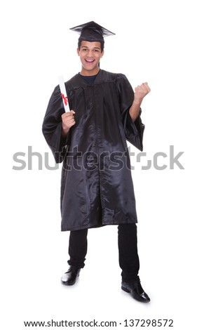 Cheerful young graduation man. Isolated on white - stock photo