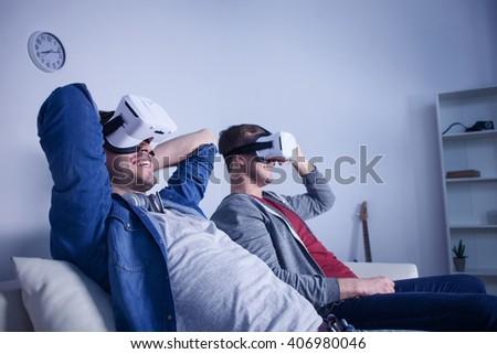 Cheerful young guys are resting at home - stock photo