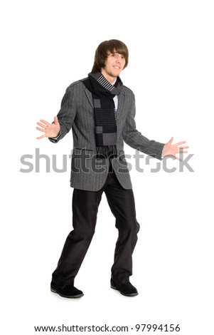 Cheerful young man dancing on a white background. - stock photo