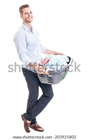 Cheerful young man holding a basket with laundry - isolated on white - stock photo