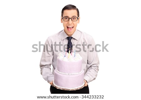 Cheerful young man holding a birthday cake and looking at the camera isolated on white background - stock photo