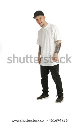 cheerful young man in casual clothes and cap looking at the camera and smiling isolated on white background - stock photo