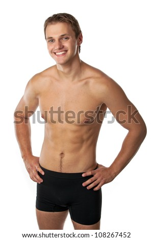 Cheerful young man in trunks over white - stock photo