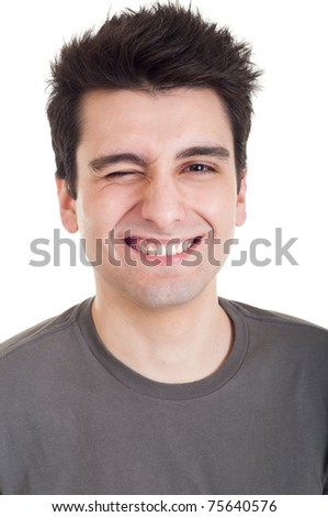 cheerful young man winking and smiling isolated on white background