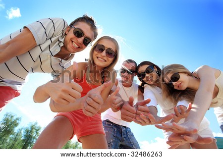 Cheerful young people having fun on a beach. Great summer holidays. - stock photo