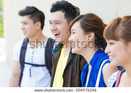 Cheerful young people, side view
