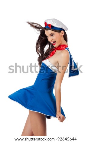 Cheerful young sailor woman in wind. High resolution image taken in studio. Isolated on white with copy space for your ad - stock photo