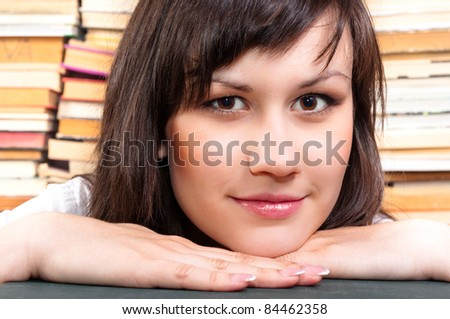 Cheerful young student and her books - stock photo