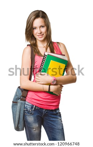 Cheerful young student with exercise books isolated on white background.