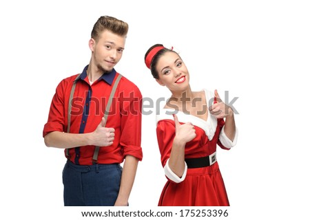 cheerful young surprised caucasian couple in red vintage clothing isolated on white