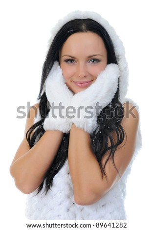 Cheerful young woman clothing in warm hat.