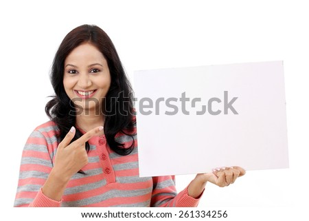 Cheerful young woman holding empty white board - stock photo