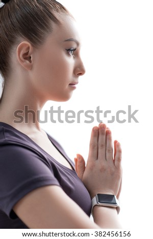 Cheerful young woman is doing yoga - stock photo