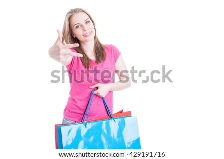 Cheerful young woman showing number three or third and carrying her shopping bags with text area isolated on white - stock photo