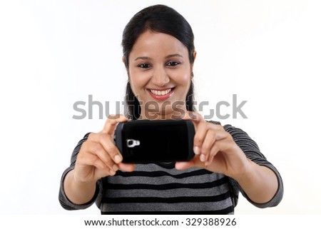 Cheerful young woman  taking selfie - stock photo