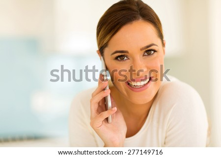 cheerful young woman talking on smart phone - stock photo