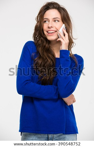 Cheerful young woman talking on the phone isolated on a white background - stock photo