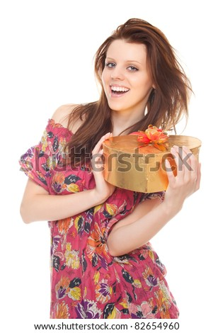 cheerful young woman with gift gold box as heart isolated on white background - stock photo