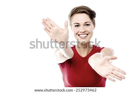 Cheerful young woman with her arms open - stock photo