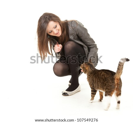 cheerful young woman with her lovely cat, full length, white background - stock photo
