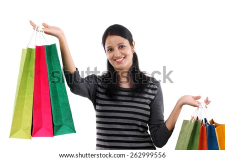 Cheerful young woman with shopping bags - stock photo