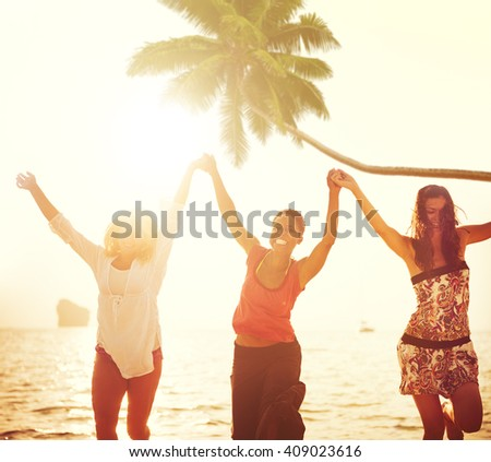 Cheerful Young Women Celebrating by the Beach - stock photo