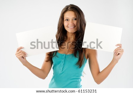 Cheerful young women holding two empty sign boards - stock photo