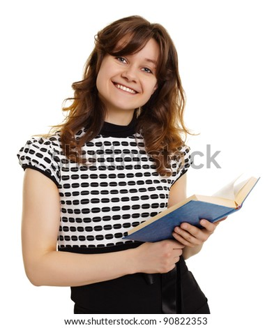 Cheerfully smiling girl with a book isolated on white background - stock photo