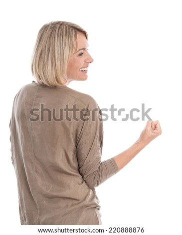 Cheering and proud isolated middle aged blond woman making fist gesture. - stock photo