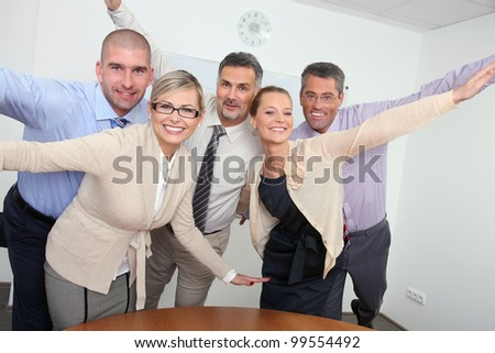 Cheering business team - stock photo
