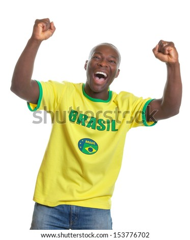 Cheering football fan from Brazil - stock photo