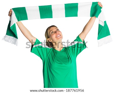 Cheering football fan waving scarf on white background - stock photo