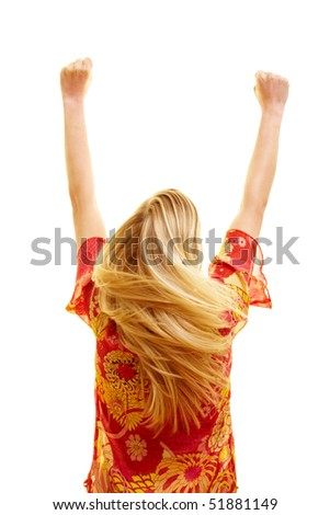 Cheering woman from behind with flying hair and clenched fists - stock photo