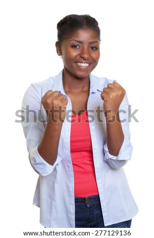 Cheering young african woman - stock photo